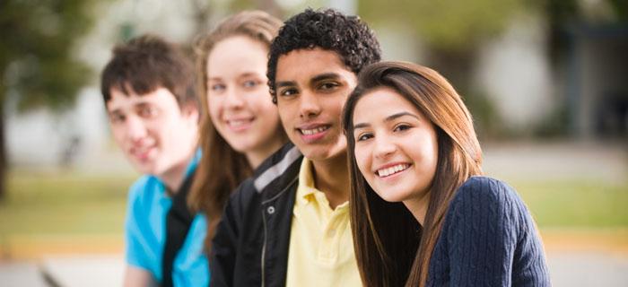 Smiling teenagers.